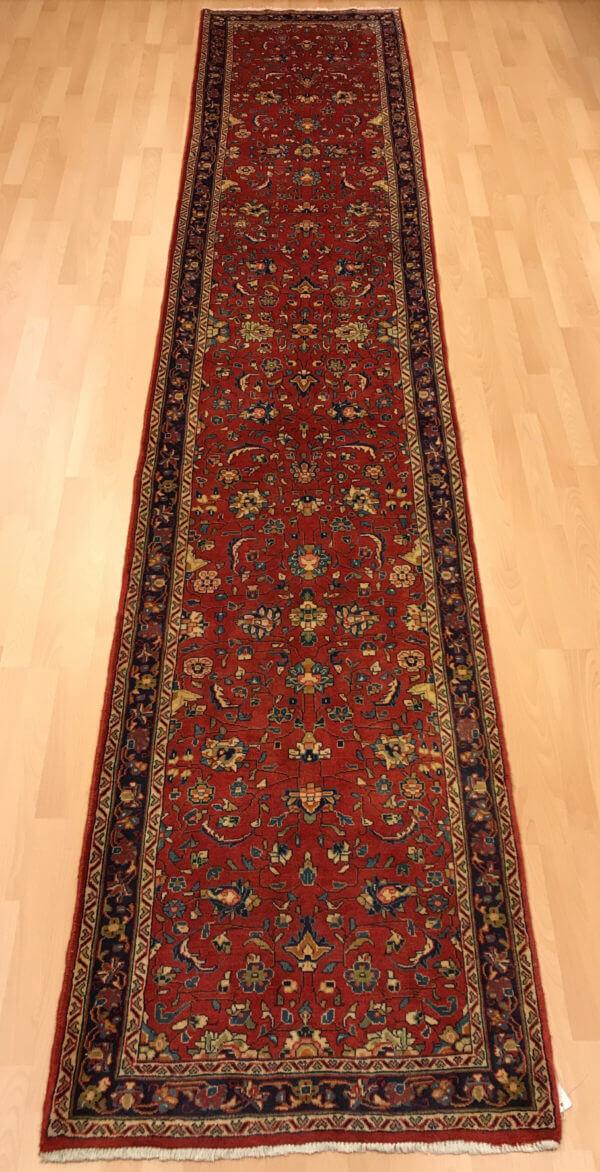 Persisk tæppe løber i røde farver